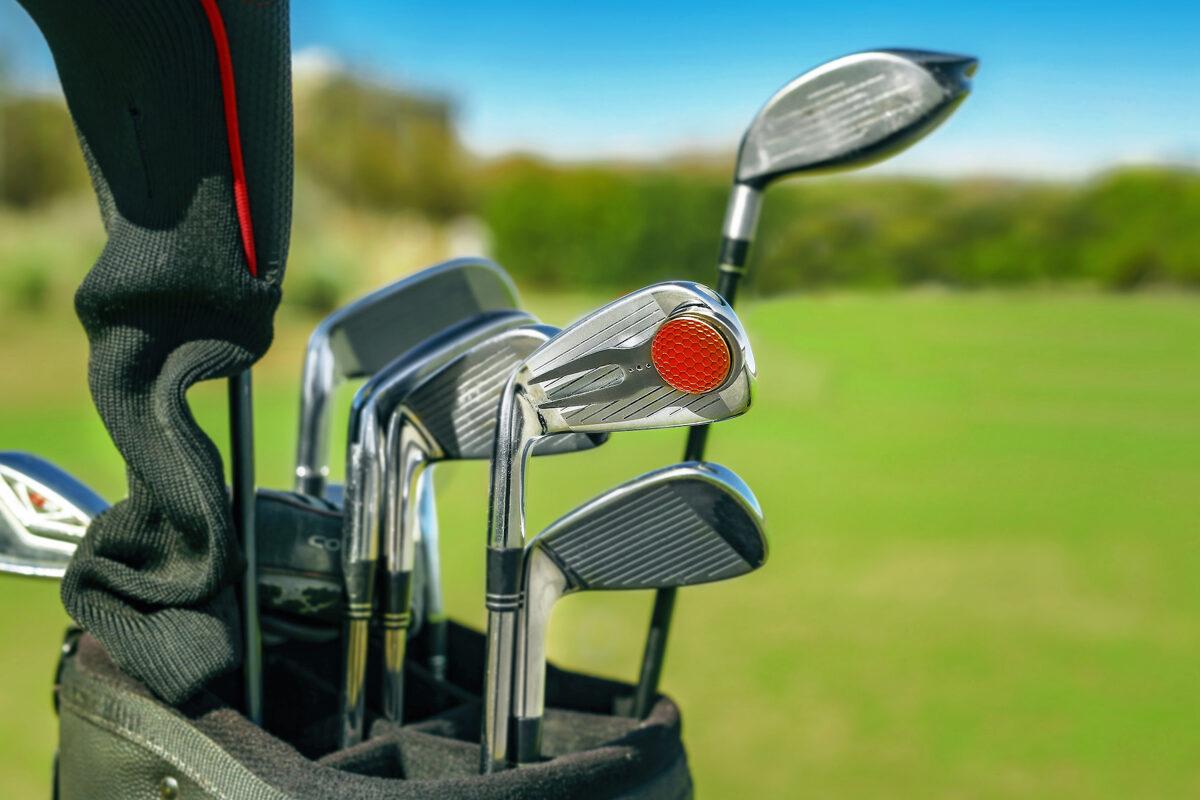 attach divot tool to golf club